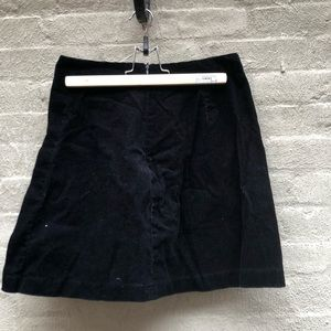 Black corduroy a-line mini skirt with pleat
